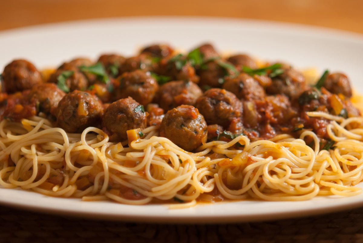 This is a clever way with meat balls. As small individual portions it makes an elegant Italian starter. The smaller-sized meatballs and thin spaghetti also make a fun and wholesome dish for children. Or piled high on a big platter it makes a great family dish to share around the table.