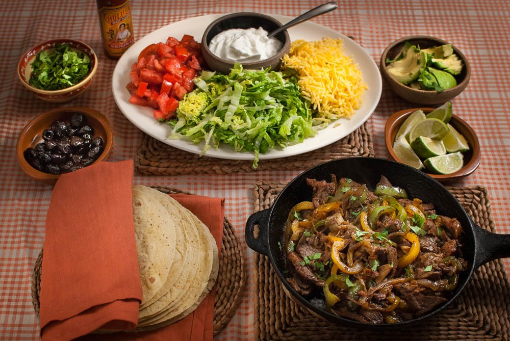 'We've been eating Mexican food for as long as I can remember. This simple fajita meal is perfect for a family feast, kids birthday party or having your mates over for the big game...'