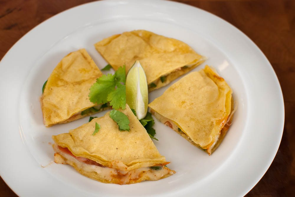 Quesadillas are a popular Mexican snack. They are best made on a hot griddle pan, but we have always made them in the microwave, rather like nachos. Here is a method I have developed which makes perfect quesadillas - straight from the microwave.