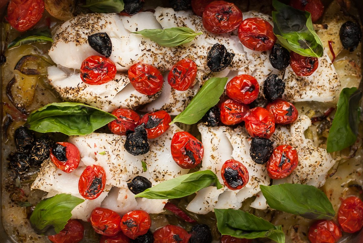 'Here's a healthy, easy Baked Cod recipe from Dad. Delicious fish on the bone that holds in all the juices, garnished with black olives and basil.'