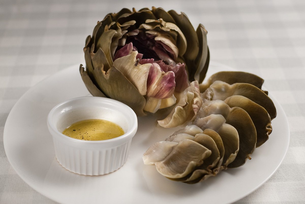 'These artichokes are a real treat! They taste amazing with a beautiful vinaigrette to dip the leaves in. But the best bit is yet to come!'