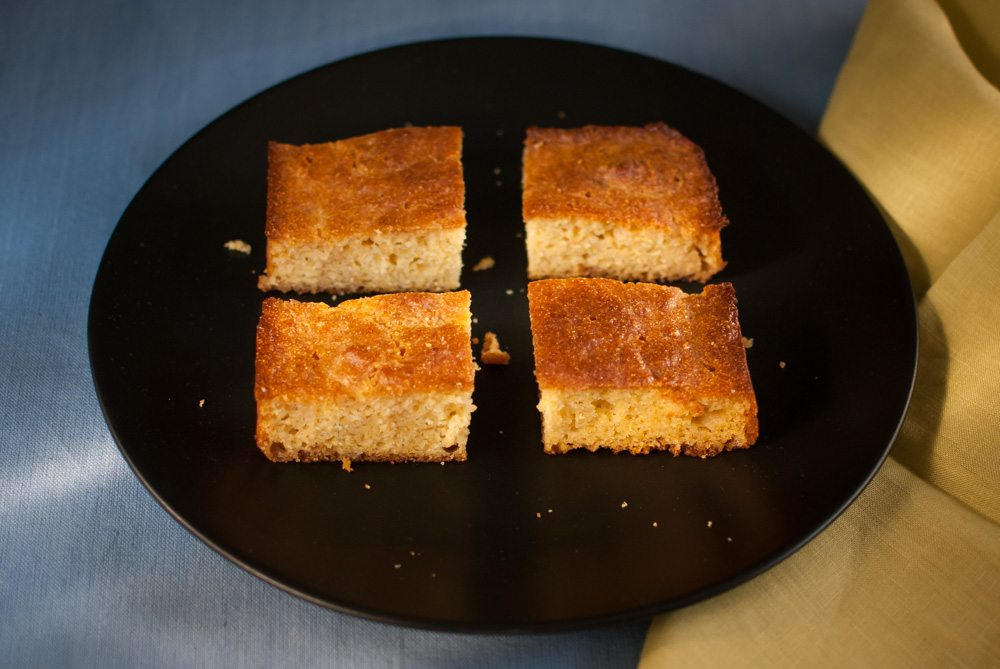 This recipe replicates the crusty and crunchy style of cornbread that is made in a cast iron skillet (but uses a normal cake tin). It also uses a cornmeal that can now be found in most supermarkets.
