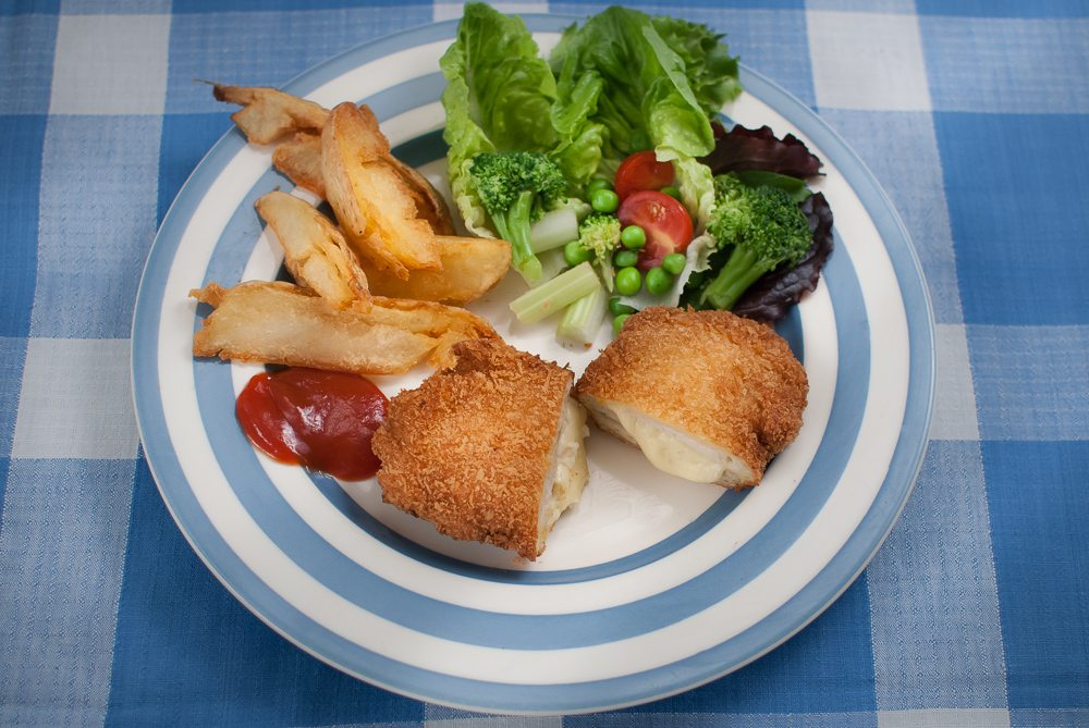 We didn't eat Chicken Kiev when we were growing up - we had cordon bleu instead. They're a lot easier than a Kiev but just as tasty. Great for kids.
