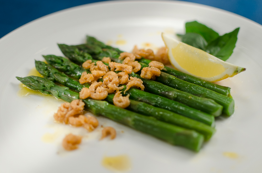 Asparagus and shellfish have an affinity with one another - prawns and crab are known as being particularly good partners. It occurred to me that the small brown shrimp form Morecombe Bay are 'potted' in butter, and we know that asparagus and butter go together - so here's my asparagus and shellfish combination, and very fine it is too.
