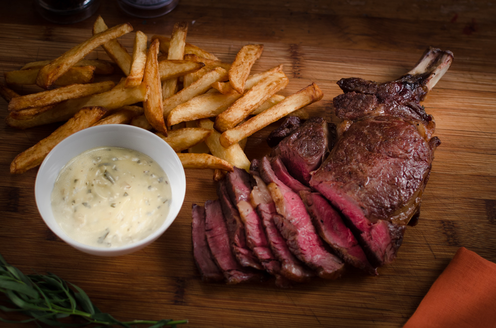 A côte de boeuf is a basically a monster steak with a bone in, or a French version of a rib of beef, But however you want to describe it, it is a wonderful piece of beef. Cook it simply and serve with chips and salad - and my no-split, light and easy béarnaise sauce.