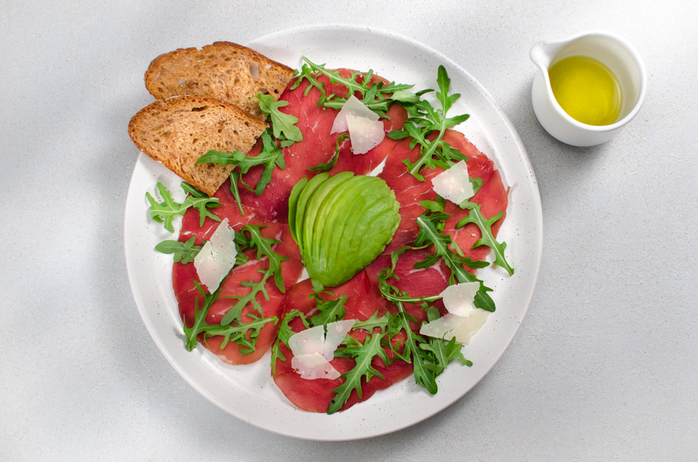 This is a standard Soho trattatoria fare of the 70's. Bresaola, rocket and Parmesan is still popular so the avocado element seems to have fallen out of favour. Put it back in - it's a good combo!