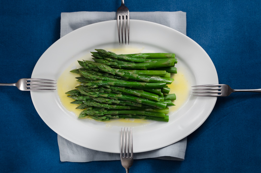 Most cooks agree that when you have an amazing ingredient it is best to prepare it as simply as possible. And they are not wrong: this must be the very best way to eat asparagus. Steamed and presented in a big stack to share. Butter, salt and lemon are optional extras...