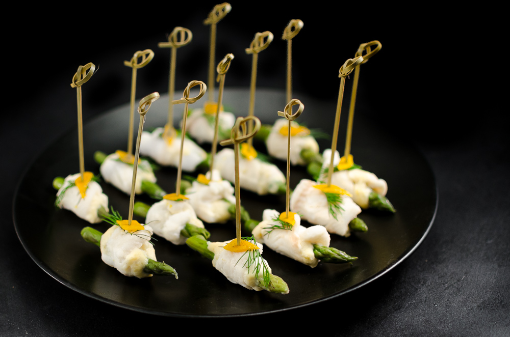 This is a spin on Escoffier's white asparagus with sauce maltaise. The two are often served as an accompaniment for a white fish such as turbot. Here the fish is plaice rolled around asparagus and a maltaise mousse and served as a canape.